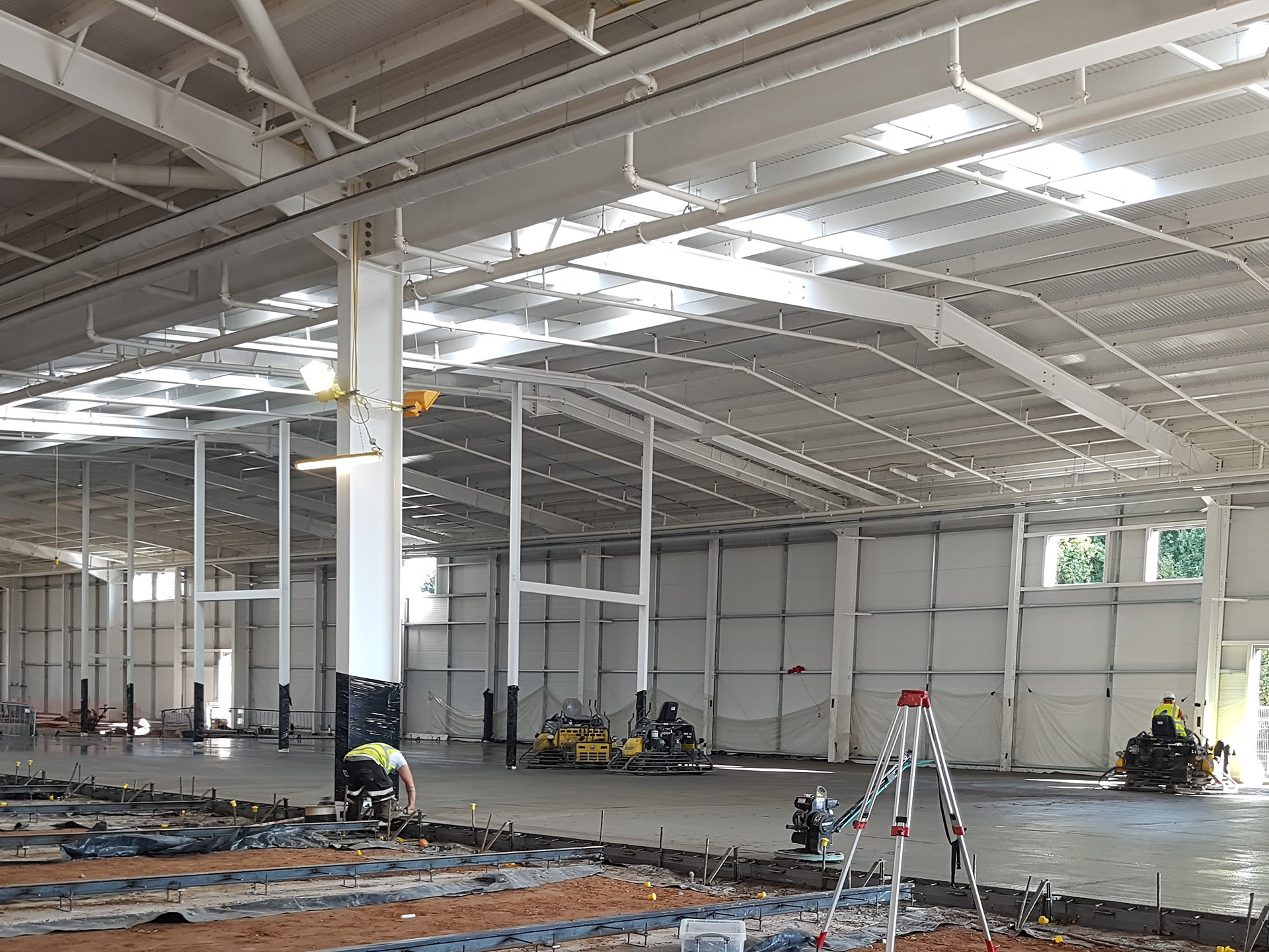 Workers laying a concrete floor