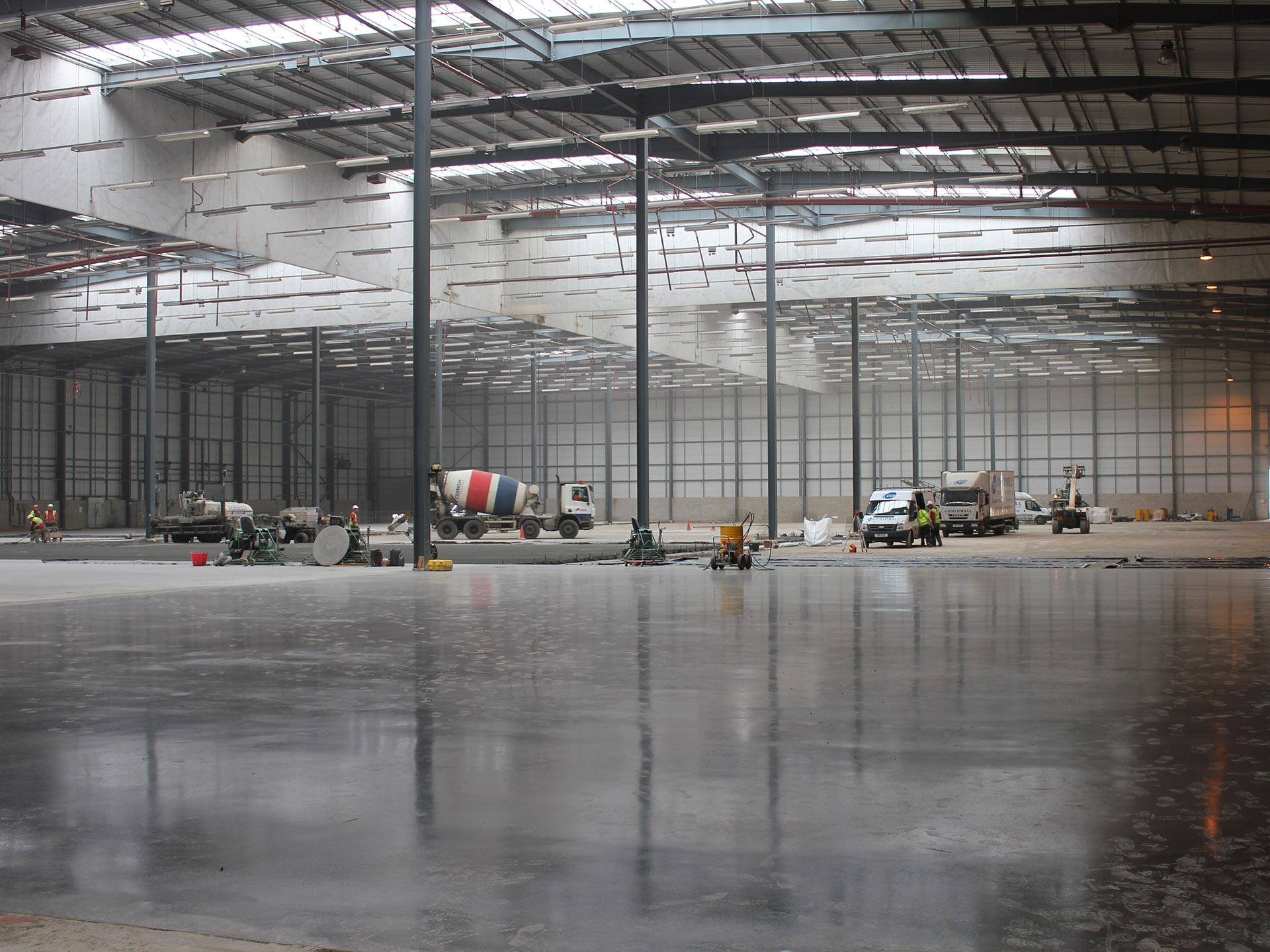 contractors laying commercial concrete floor