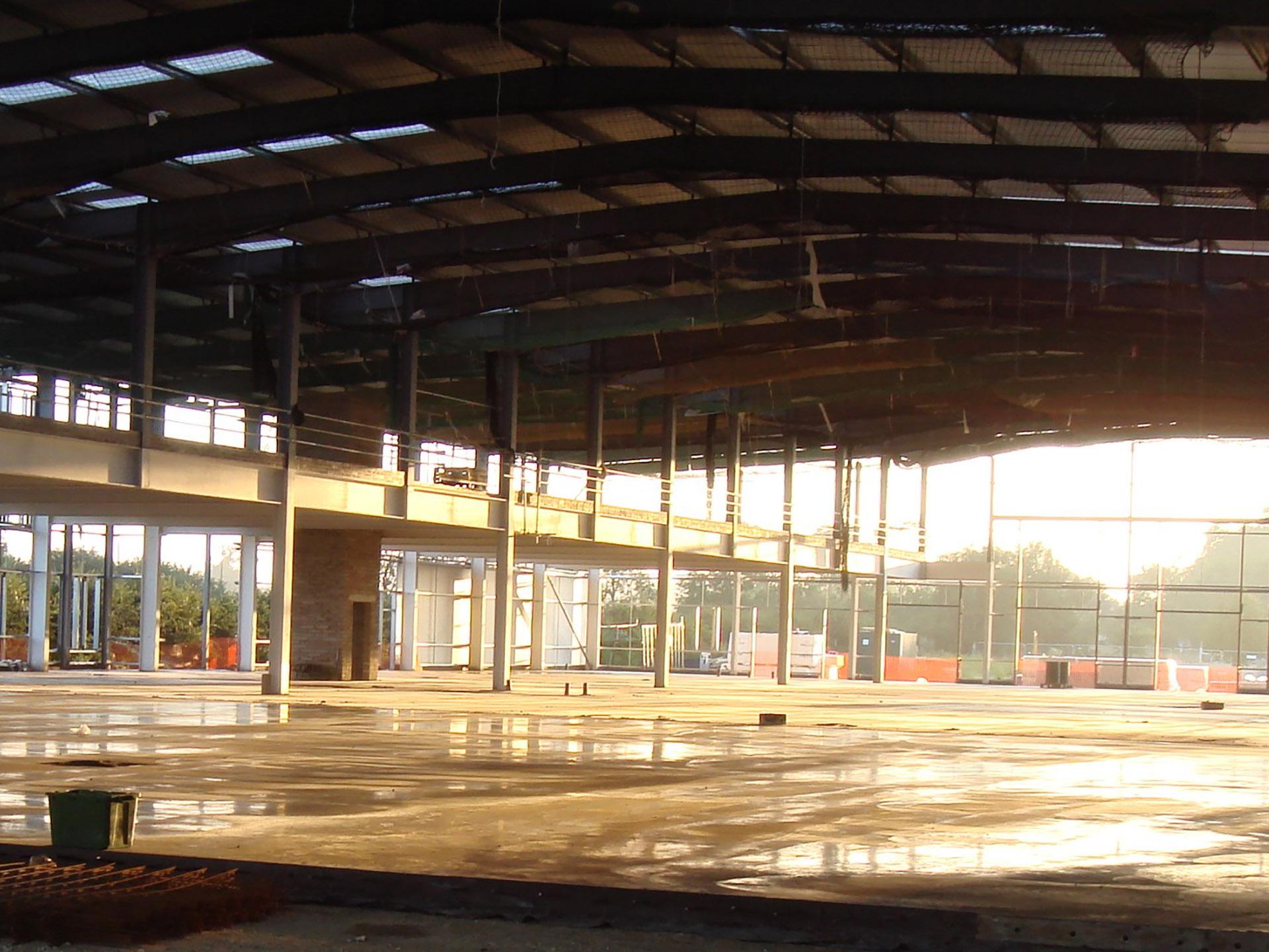 Concrete floor drying in warehouse